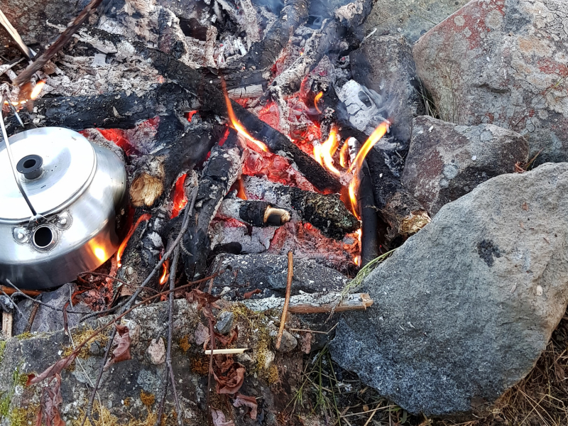 Camp fire with coffee pot
