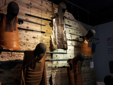 medieval armor mounted on wooden wall