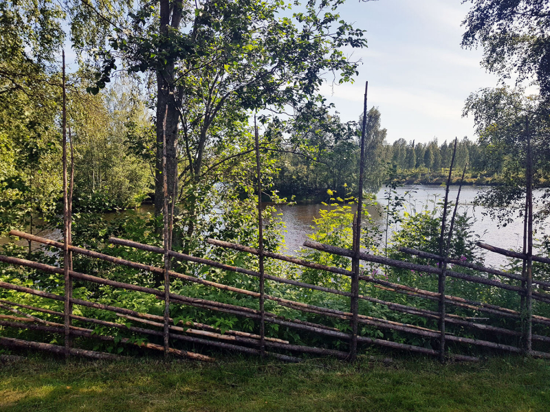 Old wooden fence with river in background