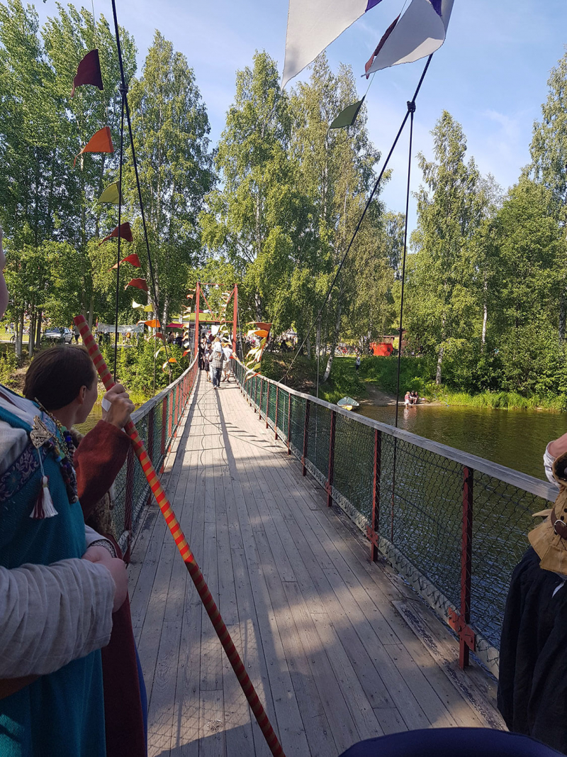 Narrow wooden bridge decorated with flags