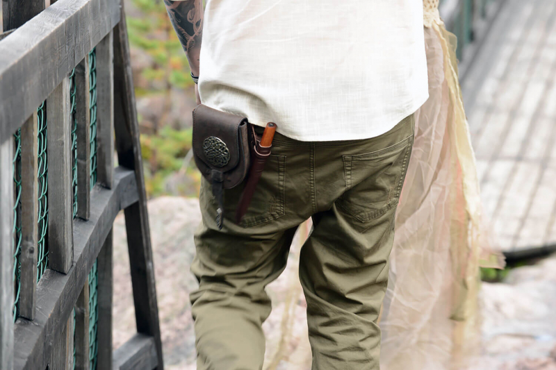 Markus from behind with leather pouch and knife hanging from belt